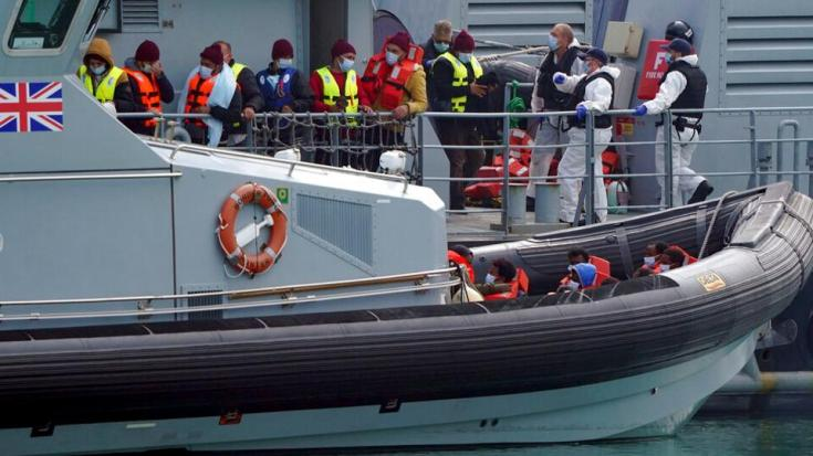 A group of people thought to be migrants are brought into port aboard a Border Force vessel, at Dover, England, Monday July 26, 2021