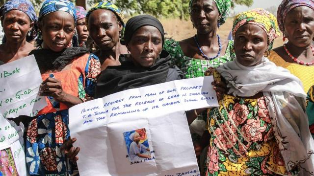 Parents and relatives of abducted Chibok Girls by Boko Haram militants hold their pictures, at Chibok Local Government in Chibok, on April 14, 2019.