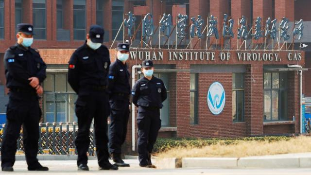 Security personnel keep watch outside the Wuhan Institute of Virology during the visit by the World… FILE - Security personnel keep watch outside the Wuhan Institute of Virology during a visit by a World Health Organization team tasked with investigating the origins of the coronavirus, in Wuhan, Hubei province, Chin onFebruary 3, 2021.