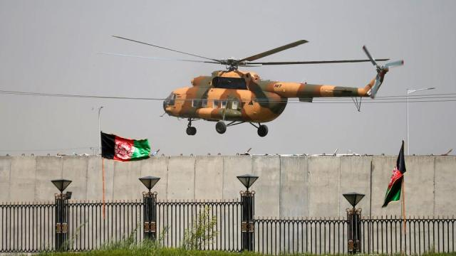 In this August 2, 2021 file photo, a military helicopter prepares to land near the parliament in Kabul, Afghanistan.