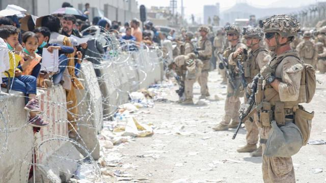 US Marines provide assistance during an evacuation at Hamid Karzai International Airport, in Kabul, Afghanistan, August 20, 2021.