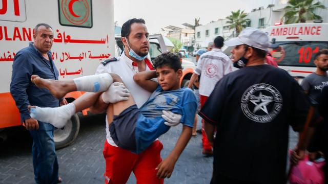 A wounded Palestinian is carried after taking part in a protest at Israel-Gaza security fence east of Gaza City, on August 21, 2021.
