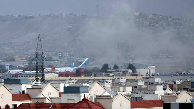 Smoke rises from a deadly explosion outside the airport in Kabul, Afghanistan, Thursday, August 26, 2021.