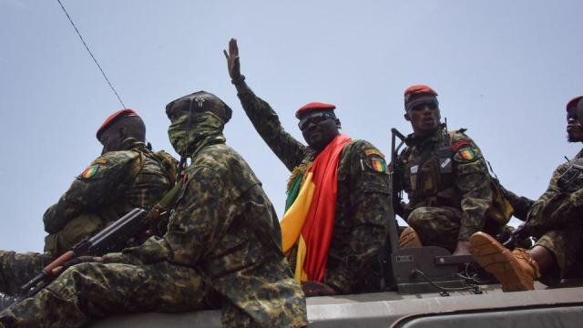 Lieutenant Colonel Mamady Doumbouya, head of the Army's special forces and coup leader, waves to the crowd as he arrives at the Palace of the People in Conakry on September 6, 2021.