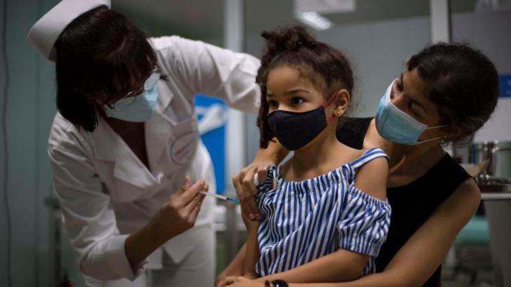 A girl gets a dose of the Cuban made Soberana-02 vaccine in Havana, Cuba, Tuesday, August 24, 2021.