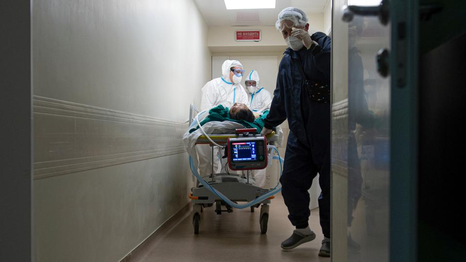 Medics transport a patient with coronavirus at City hospital No. 52 for coronavirus patients in Moscow, Russia, July 13, 2021.