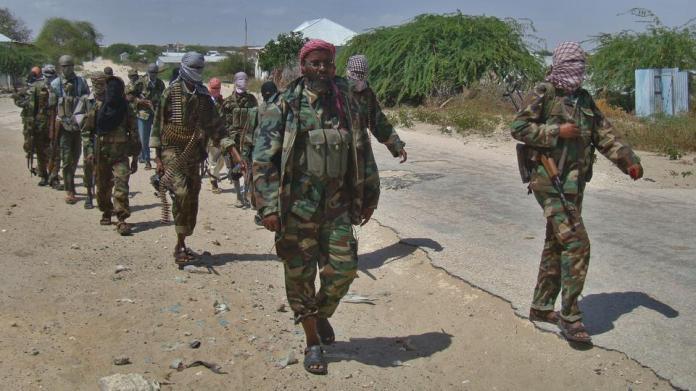 Al Qaeda linked al Shabab recruits walk down a street on March 5, 2012 in the Deniile district of Somalian capital, Mogadishu, following their graduation.