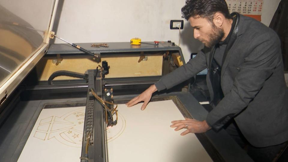 Syrian artist Youssef Shaabou working on an engraving at his workshop in Azaz in northern Syria.