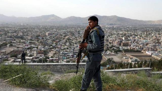 An Afghan policeman keeps watch at a hilltop in Kabul, Afghanistan July 23, 2019.