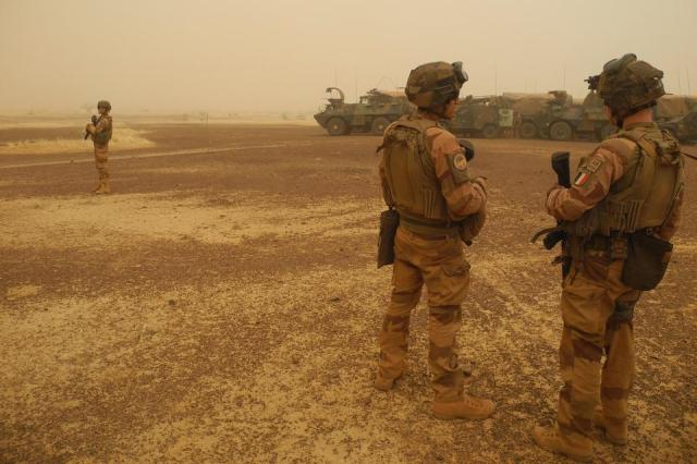 French soldiers keep watch during a break in the military convoy's trip between Gossi and Hombori ahead of the start in Mali's Gourma region on March 26, 2019