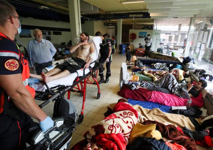 An asylum seeker is transported to a hospital by healthcare workers on the campus of Belgium university ULB, where hundreds of migrants are going on hunger strike, in Brussels, Belgium June 29, 2021.