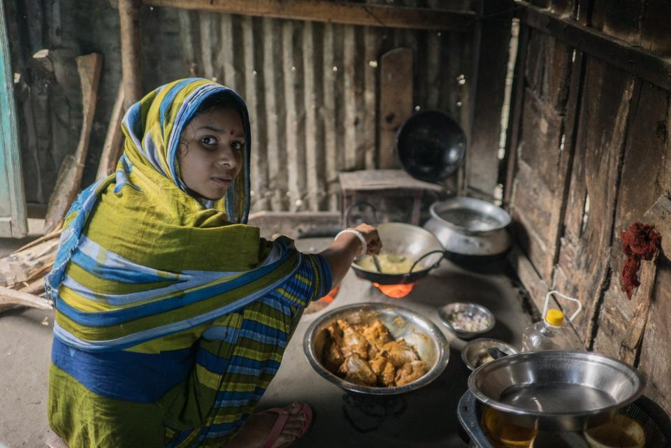 Kartik's 19-year-old wife Happy is making a meal at the family's makeshift kitchen in Bangladesh.