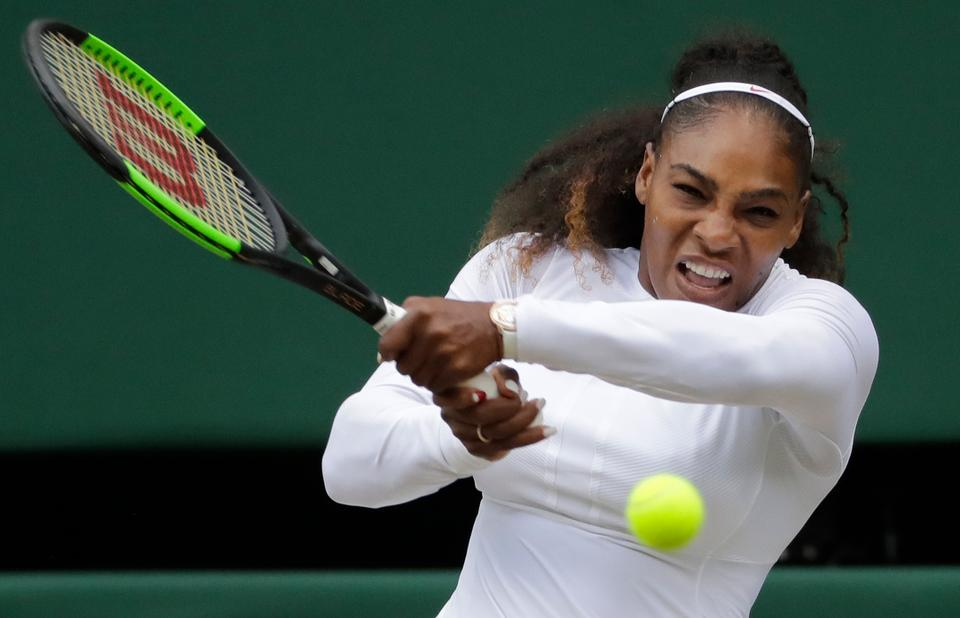 Serena Williams returns the ball to Angelique Kerber during their women's singles final match at the Wimbledon Tennis Championships.