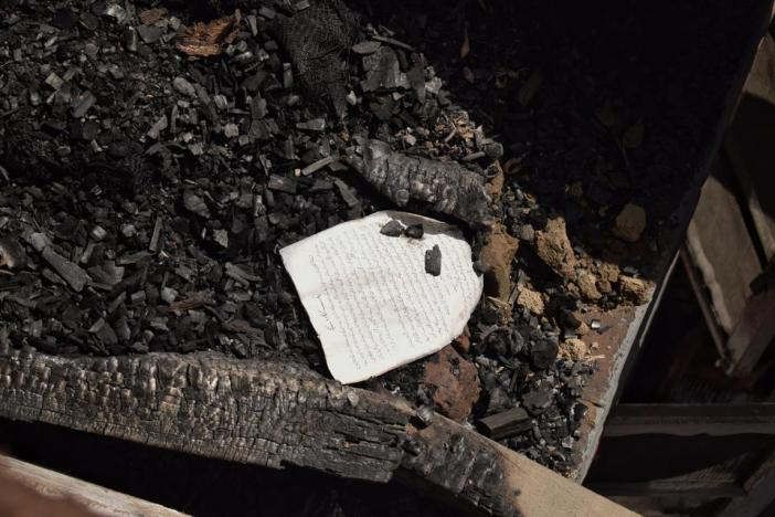 The remains of burnt books in the rubble of a house that was blown up in south Kashmir earlier this year.