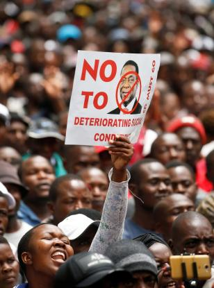 Supporters of the opposition Movement For Democratic Change (MDC) party take part in anti-government protests over economic hardships in Harare, Zimbabwe (November 29, 2018).