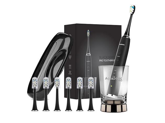 The Aquasonic PRO Toothbrush with 6 ProFlex Brush Heads, Wireless Charging Glass, & Case