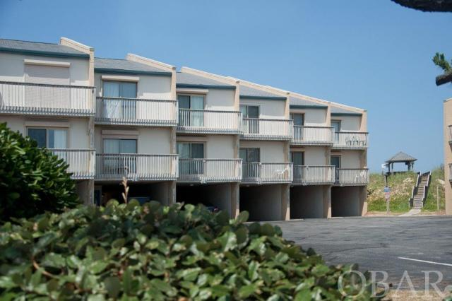 OCEANFRONT, 3 bedroom, 3 bathroom condo in the heart of Nags Head. This gorgeous beach was included in the Nags Head beach nourishment and a stable dune offers wonderful protection. The home is well maintained and benefits from several upgrades. Tile floors, New HVAC, New Hot Water Heater, paint and decorated all in 2018.  Enjoy a beverage from the wet bar as you look out over the ocean from large private decks.  Spacious grand master with large bath and jetted tub.  Quiet enjoyment as you own all three levels, no neighbors on top or below.   Private interior laundry and lots of storage including a large storage area in the carport and outdoor shower. Fully furnished, the home is ready to be enjoyed and performs well in a rental program now.  Centrally located you can walk to restaurants, stores and entertainment. The Quay is a well managed and maintained complex featuring an outdoor pool, tennis court private beach access with dune top gazebos and beach showers to rinse off when you return home from the ocean on wooden boardwalks. Condo fees include water, sewer and cable.