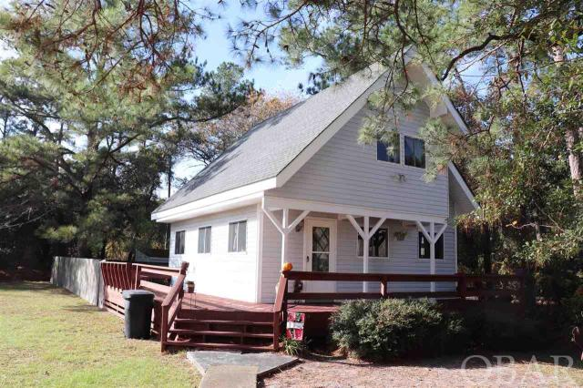 Cute Cottage on large lot in the amenities filled Colington Harbor. Year round tenant lease in place for guaranteed income through November 2019.  Tenant would like to continue with new owner.   Colington Harbor Association offers basketball, sound-front park complete with playground, picnic pavilion, sound beach access.  You can join the pool and tennis club as well