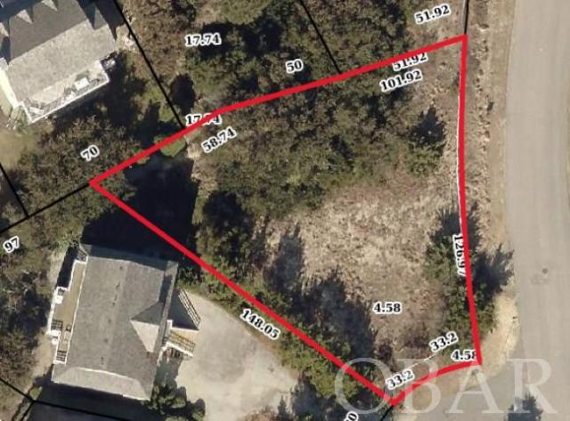 One of the last chances to build in the highly sought after Water's Edge subdivision in the Village at Nags Head. Located on a quiet cul-de-sac. Walking distance to the southern sound-side Village pier and park. Close to Outer Banks attractions like Jockey's Ridge and the Oregon Inlet Fishing Center, excellent restaurants, grocery stores, outlet shopping, and Nags Head fishing piers. Beach Club including tennis and Nags Head Golf Links memberships are available. Use all or as little of the amenities offered in the Village and only pay for what you chose to use. Free shuttles will deliver you to sound side parks and piers, beach access and bath house are available for all owners and guest. Beach club and golf links are private memberships.  Proposed house plans and recent survey for this property are available.