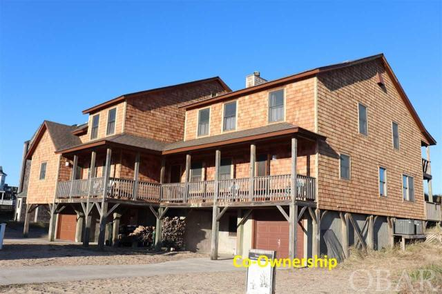 """Duplex Co-ownership Segment 3 in Hawks Nest 13B. Own a 1/10 co-ownership or 5 weeks in this beautiful oceanfront Nags Head home. Walk out your door on your private access to the beach and enjoy the ocean. Every year the weeks rotate so everyone can enjoy winter, fall, spring and summer in their home. Hassle free, carefree living is yours because the association dues pay for all expenses - taxes, insurance and utilities including cable and Wifi. Beautiful Ocean Views. Tastefully furnished 4 bedrooms, 3 baths, laundry area, outdoor shower, grilling area with new charcoal covered park style grill and garage with storage. Decks front and back with expansive views.  Wood burning fireplace with split firewood provided. What a great opportunity to vacation in an oceanfront home at a fraction of the cost. Owners may rent the weeks they choose not to enjoy themselves.  BRAND NEW CEDAR SHAKE SIDING!  Weeks for 2020 are Mar. 13TH-20TH ; Two weeks in a row Jun 26TH-July 10TH please note this is a July 4th holiday week. The schedule includes ten designated """"holiday weeks"""" and you will receive one every year ; Sep.18TH-25TH ; Dec 4TH-Dec 11TH"""