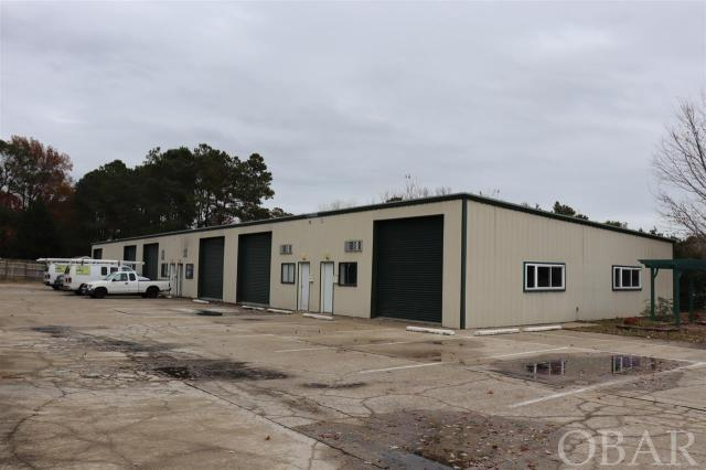Six 1400 sq. ft. warehouse/office units for a total of 8400 sq ft. Concrete flooring, metal building, plumbing, 200 amp electrical with 220 available. 12-ft roll-up doors and up to 14 ft ceilings. Each unit metered separately. Great opportunity for owner/occupier or investor. Convenient location near Kilmarlic on Hwy 158. Two units currently on a month-to-month lease.  1 Mile from Water park and 4 miles from Wright Memorial Bridge to Kitty Hawk.  Current owner wishes to sell as one building, potential for new owner to condo building and sell units separately if desired.