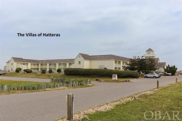 """Easy, care free, and all inclusive ownership. A simple answer to big time vacation enjoyment. First floor easy access, sound view condo in the heart of Hatteras Village. This condo has been lovingly decorated and cared for and is the perfect place to stay while enjoying the beautiful Cape Hatteras Sea Shore.  Operation maintenance, all utilities, & amenities are all included in the HOA  A comfortable living room w/ chair & sofa w/ a queen pull out bed & flat screen TV/DVD. There is a well stocked kitchen w/ breakfast bar (2 bar stools), fridge, dishwasher, 2 burner range, microwave / convection oven. Full bath (w/ tub). King bedroom w/ sliding door leading to """"sound side"""" patio with 2 tall chairs, table and amazing sunsets served nightly.  The association provides a large commercial ice machine and laundry room close by.  This condo is in the perfect location with many great options surrounding you. From the beach that is just across the street (200 yards), the large community pool located just out your door (open Mid April - Late Sept.), to the many shops and restaurants in the Hatteras Landing shopping plaza, you will find that you can walk to about everything! Within walking distance: boat docks, shopping, restaurants, world class Sport fishing charters, kayak tours, and The Grave Yard of the Atlantic Museum.  Make sure to plan a day exploring Ocracoke Island (just a ferry ride away). Rent beach bikes and explore the rest of Hatteras Island. Whether you want to relax on the beach with a book, swim, surf, fish, explore historic sites, bird watch, try your hand at water sports, or sit by the pool.  The association provides a gas grill on pool deck, park grill area, fish cleaning table, and outside shower."""