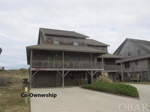 Easy, care free, and all inclusive oceanfront Co-ownership. This Duplex in Five Seasons covers all your needs.  Own a 1/10 co-ownership or 5 rotating weeks in this beautiful oceanfront Nags Head home. Walk out your door to the beach and enjoy the ocean. Every year the weeks rotate so everyone can enjoy winter, fall, spring and summer in their home.  Owners do trade weeks as well to fit their schedules with other owners. Hassle free, care free living is yours because the association dues pay for all expenses - taxes, insurance, cable and all utilities. Beautiful Ocean Views. Tastefully furnished 4 bedrooms, 3 bath, laundry area, outdoor shower, grilling area and garage with storage and owners lockable storage area.  Master boast a huge jetted tub and separate shower Decks front and back with expansive views.   Spacious open floor plan in kitchen and living area.  What a great opportunity to vacation in an oceanfront home at a fraction of the cost. Owners may rent the weeks they chose not to enjoy themselves.