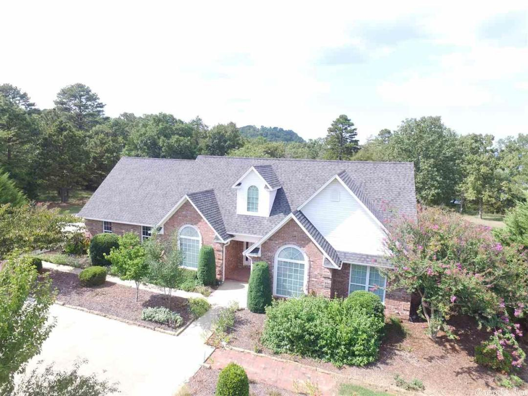 SPRING is HERE! You know you would LOVE to be on the LAKE! Your family will enjoy the convenience of this home. Complete with it's own PRIVATE boat dock with a lift on Lake Dardanelle's Piney Bay! This wonderful custom built, energy efficient home includes a HUGE 30x30 detached double garage and workshop/Mother in Law quarters. Enjoy the wonderful scenes of nature from the sunroom or the oversized deck! This one is definitely better viewed in person. Call today and schedule a showing!