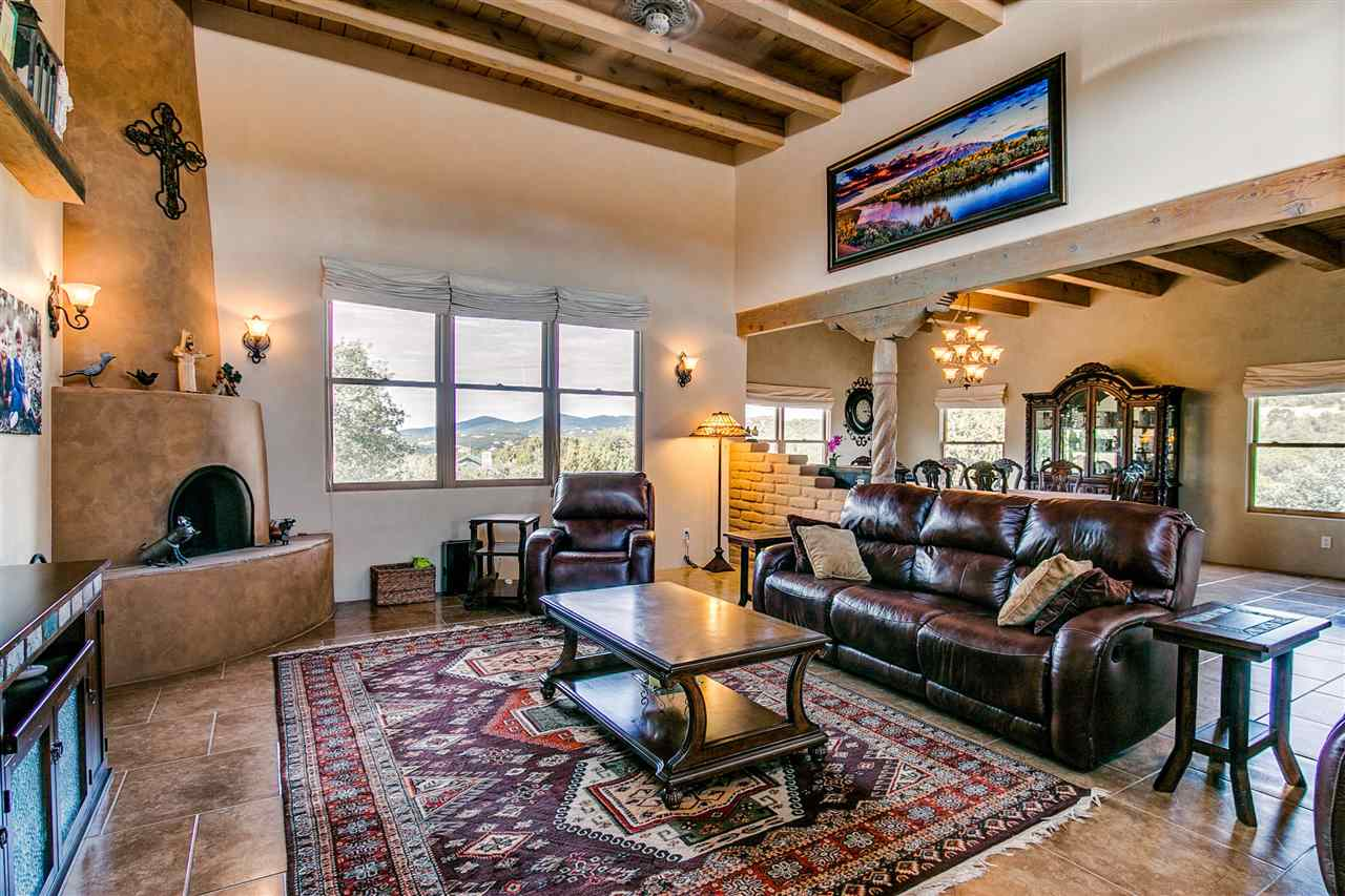 SUPER DUPER SW STYLE HOME! Gorgeous SW style home with tons of character! Wood ceilings and beams, vigas, wood windows, decorative tile lined skylights, beautiful maple cabinetry throughout, granite countertops in super spacious kitchen and baths! Stainless steel appliances, TONS of cabs and natural light! Kiva fireplaces, pellet stove in HUGE dining room! A TRUE MASTER SUITE! SO SPACIOUS! Bring on the California KING! Full master bath, huge walk in closet, copper sinks, jetted tub, Kiva fireplace, Fantastic floor plan! Beautiful neutral tile flooring throughout, Venetian plaster, very spacious and tons of storage! Refrig. air, newer TPO roof, AWESOME meadow and mountain views! 3 car garage plus detached workshop, terrific and super convenient location! NO HOA!