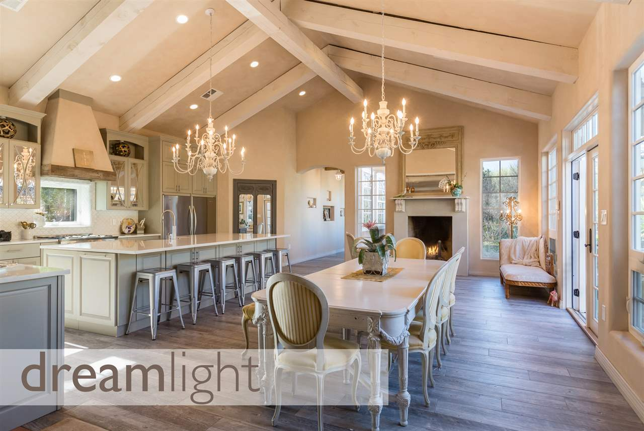 Exquisite North Valley 6 Bedroom, 4 1/2 Bath Home, Renovated 2014-15, w/2-car garage on .72 Landscaped Acres. The high, beamed-ceiling Dream Kitchen has quartz counters & oversized island w/built-in wine rack, Arabesque tile backsplash & pro-grade stainless steel appliances: 6-burner gas range, double oven, double refrigerator & double dishwashers. Creamy Venetian-plaster, hardwood-look ceramic tiles & custom stamped-concrete floors are stylish & durable. 4 fireplaces. Amazing Master Suite with garden tub! Lounge in the cabana by the salt-water pool or in any of several outdoor seating areas under arbors & verandas surrounded by lush landscaping. Enjoy the cascading waterfall while grilling on the back patio. Near I-25, Alameda Open Space, Corrales & Cottonwood.