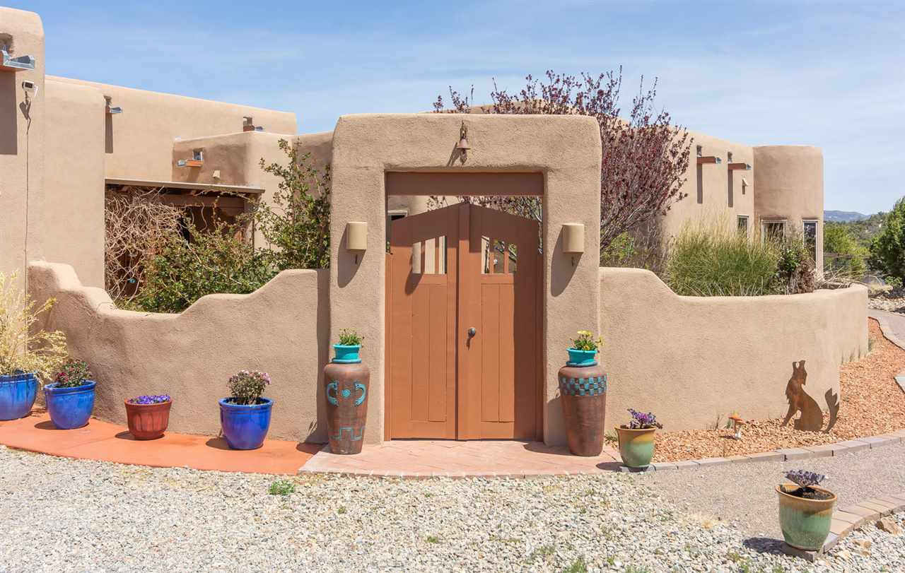 Tucked away with end-of-the-road privacy and serenity, this warm, pueblo-style home offers a sun-filled, open floor plan and is surrounded by private outdoor living spaces, colorful plantings, flowering shrubs and a starburst of flowers*So many amenities! *Mountain views*Clear, sparkling night skies*Plenty of space for your pets/animals*A chef's delight kitchen w/ granite counters and cherry cabinets*Beamed ceilings*Spacious formal dining plus breakfast nook*Great Room living highlighted by the Kiva fireplace* Over the past few years the carpet, roof, hot water heater, boiler, water softener, dishwasher, washer and dryer have been replaced*All yours in an enclave of fine homes! Beauty that must be experienced!