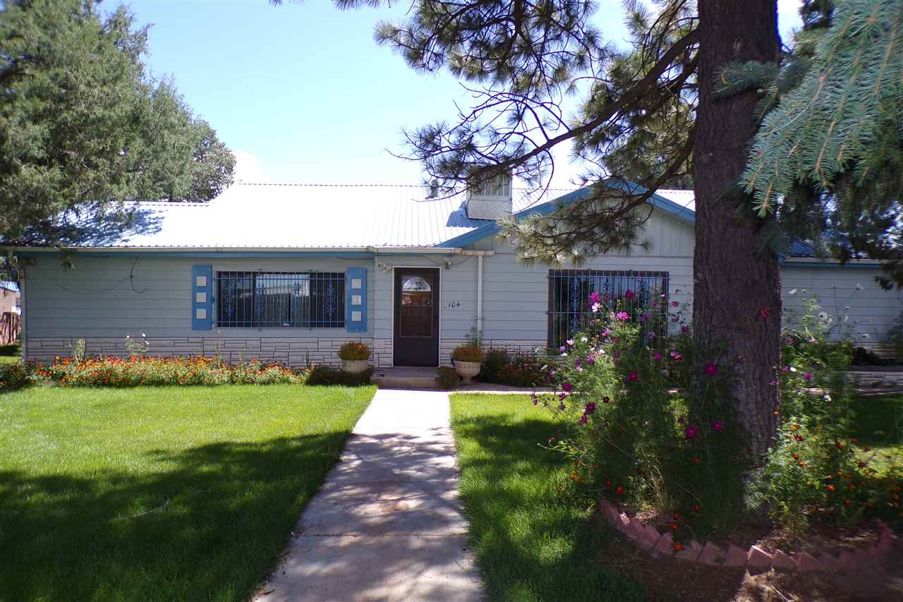 This 6800 sf home in Moriarty,  NM  features 5 bedrooms and 5 bathrooms. This is an older home that has been well cared for, has seen a number of children into adulthood and has hosted many parties for family, friends and community. The home features two large living areas, wet bar, large dining room and breakfast nook. The kitchen is modern and easy to work in with many cabinets and built-ins. Not only is there plenty of living space, there are many entertainment opportunities with an indoor pool, large patio with outdoor kitchen, a basketball court and a game room. The yard is simply magnificent with many mature trees, lush lawn and an array of flowers. This is small town America in the heart of New Mexico along the I40 corridor.  Albuquerque and Santa Fe are less than an hour away.