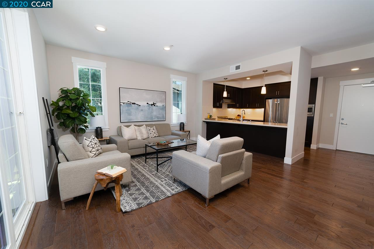 This single-level executive penthouse condominium is located close to the vibrant downtown area of Walnut Creek. This move-in ready home was recently built in 2016 and has all the luxuries needed for executive living. The open floor plan offers many gorgeous upgrades throughout including beautiful hardwood floors, plush carpet and designer light fixtures. The beautifully upgraded kitchen is light and bright with stylish modern cabinets, quartz countertops, subway tile backsplash, high-end stainless steel appliances, a built-in microwave, and a gas range.  The spacious family room has high ceilings, picturesque windows to allow for an abundance of natural light and a balcony. There are two bedrooms, OFFICE and two full bathrooms, both featuring designer tile flooring, quartz counters and frameless glass shower doors. The master bedroom features an oversized walk-in closet. Desirable location close to Walnut Creek Schools, Civic Park, John Muir Health Center, restaurants and shopping.
