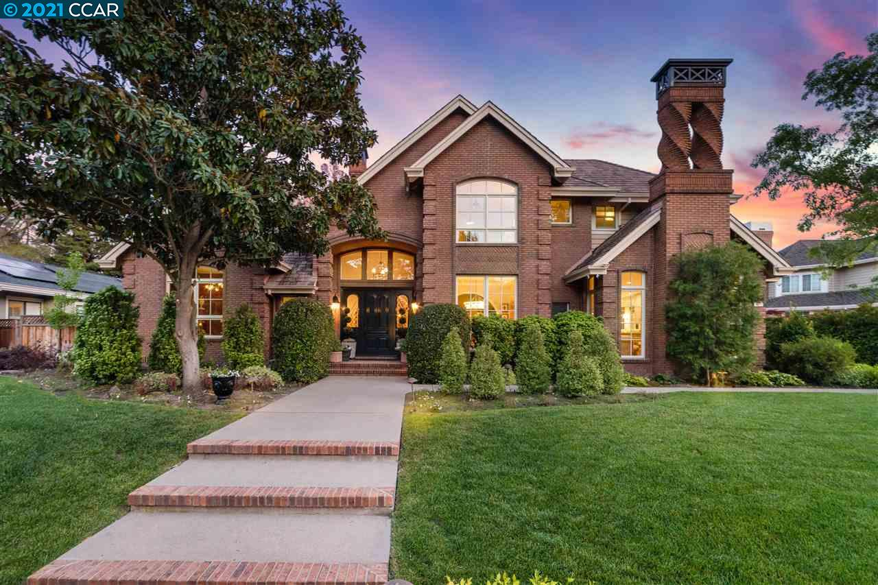 Exquisite gated home completely remodeled throughout on quite cul-de-sac, walking distance to Roundhill CC. Expansive backyard: over 1/2 acre flat lot, pool/spa, multiple patios, lush lawn, firepit & mature landscaping. Open floor plan: grand entryway, soaring ceilings, living rm w/built-ins & brick fireplace, formal dining rm & family rm w/picturesque windows. Highlights: hardwood floors, designer lighting, custom cabinetry, designer drapes & woven wood blinds. Upgraded kitchen: satin quartzite counters, custom cabinetry, aged brass hardware & range hood, high-end SS appliances, center island w/bar seating & heated tile floors. 640-bottle wine cellar. Main level: guest bdrm/bath & master retreat w/gas fireplace & backyard access. Ensuite: oversized shower, stand alone tub, heated tile floors & walk-in closet w/island. Upper level: bonus rm w/built-ins, bar & gas fireplace. All baths/windows/doors recently upgraded. Close to top-rated schools, shopping, dining, trails & freeway.