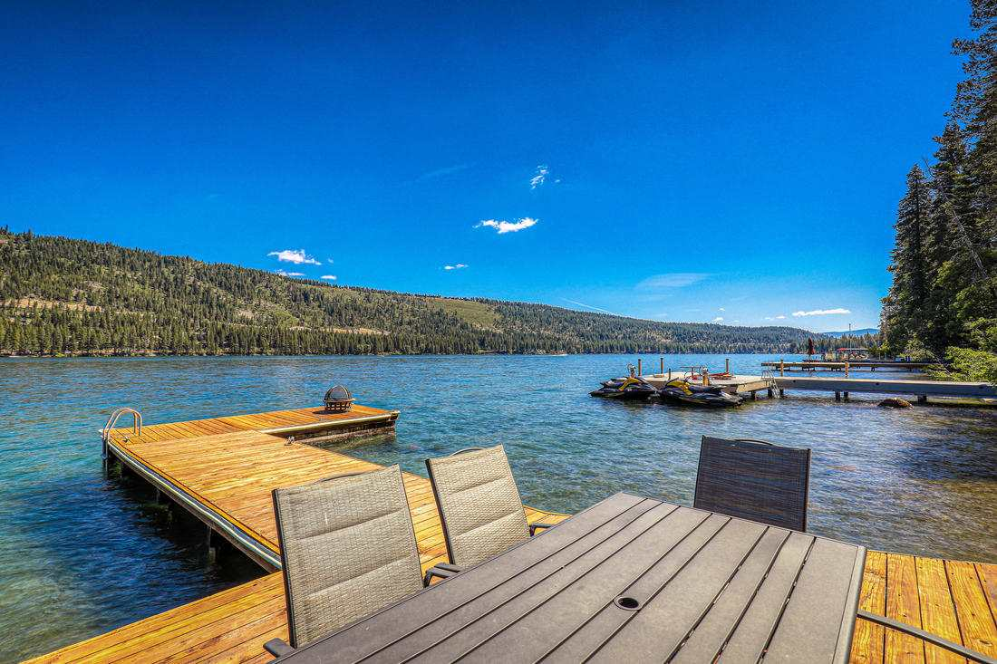 This truly quintessential lakefront A-frame with a private pier rests on the tranquil south shore of Donner Lake.  Embrace the expansive lake views through the large windows and decks on each floor.  The private L shaped pier is the ultimate way to enjoy the lake. The top floor has 3 bedrooms with vaulted ceilings and a hot tub on the deck.  The open floor plan of the main room and game room below is perfect for entertaining.  Lakefront living at a great value!