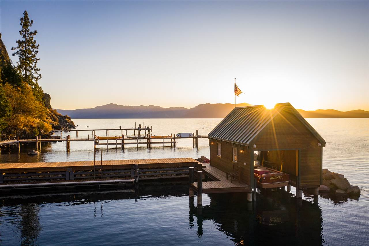 """A rare Tahoe shoreline beauty with history, taste, and everything a home in this price range should command. Superbly remodeled to depict comfort and class, this historic property eschews the cliché of """"mountain modern,"""" largely as a result of its 1938 architecture's timeless lines and proven fortitude. The 100' of sapphire shoreline, complete with buoy and breakwater, offers walk-in access to a sandy-bottom beach; and rarest of all, a private rock crib pier with a cherished original boathouse."""