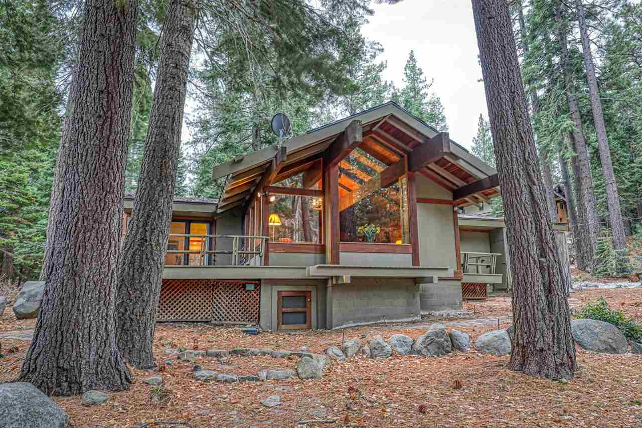 A rare opportunity to join the coveted Moana HOA is finally available. This classic Mountain style home is perfectly positioned at the confluence of McKinney Creek and Lake Tahoe and steps from the private beach, pier, and buoy's. The great room is designed for enjoying time with family and friends by the grand stone fireplace while they gaze at the Aspen lined creek and indulge views of Lake Tahoe. The chef of the home will thrive in the spacious kitchen that intuitively flows into the dining room.
