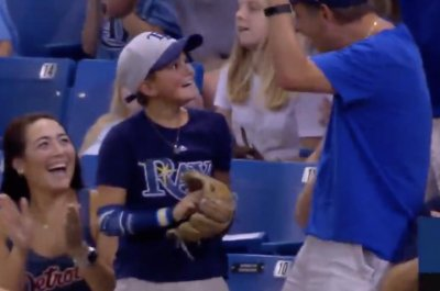 Watch: Boy grabs homer at Rays game, has biggest grin ever Boy catches homer at Rays game cant stop smiling