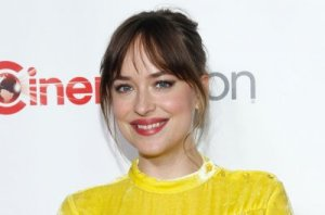 Note: Dakota Johnson says she used George Clooney's name for reservations