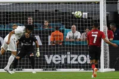 Watch: Alexis Sanchez grabs goal, assist in Manchester United's win vs. Real Madrid International Champions Cup Manchester United slips by Real Madrid