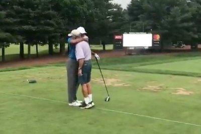 Watch: Tiger Woods hugs former caddie Mike 'Fluff' Cowan Watch: Tiger Woods hugs former caddie Mike 'Fluff' Cowan Tiger Woods hugs it out with former caddie Fluff