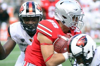 College Football Roundup: Minus Meyer, Buckeyes put on air show College Football Roundup Minus Meyer Buckeyes put on air show