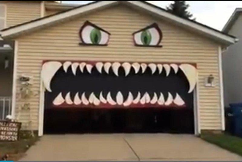 Watch: Garage door forms the mouth of Halloween monster