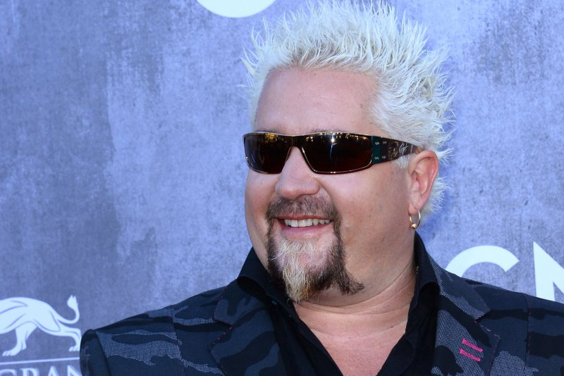 Guy Fieri dons normal hairstyle in altered viral photo  UPIcom