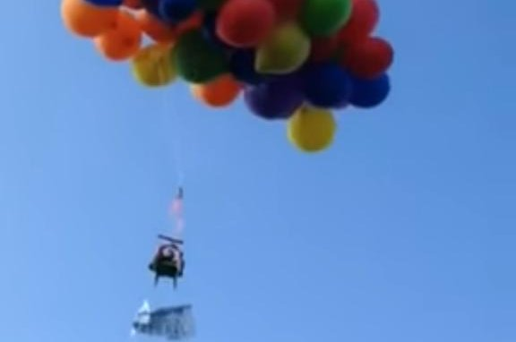 chair with balloons blue wingback slipcovers watch calgary balloon pilot fined 20 000 for 2015 stunt canadian nearly lawn flight