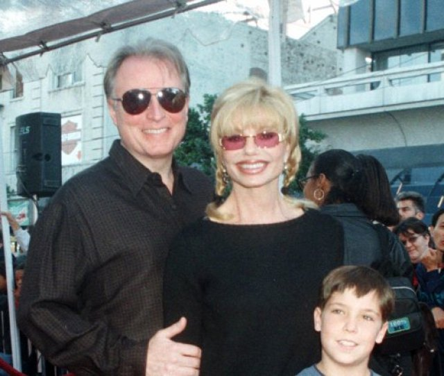 Actress Loni Anderson And Her Longtime Companion Jeff Pose With Quentin The Adopted Son Of Anderson And Actor Burt Reynolds File Photo