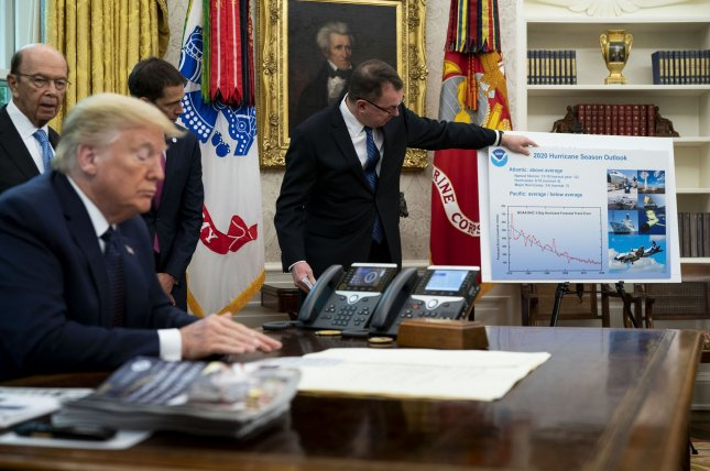 President Donald Trump listens as he receives a briefing on the 2020 hurricane season Thursday in the Oval Office. Pool Photo by Doug Mills/UPI
