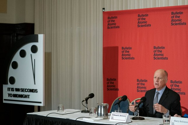Bulletin of Atomic Scientists Executive Chair Jerry Brown announces Thursday the Doomsday Clock was moved forward 20 seconds to its latest time in history. Photo by Ken Cedeno/UPI