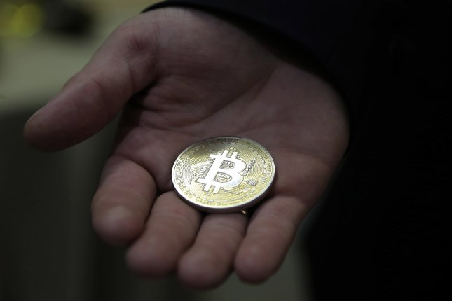 Bitcoin soars to all-time high -- over $63,000 -- ahead of ...