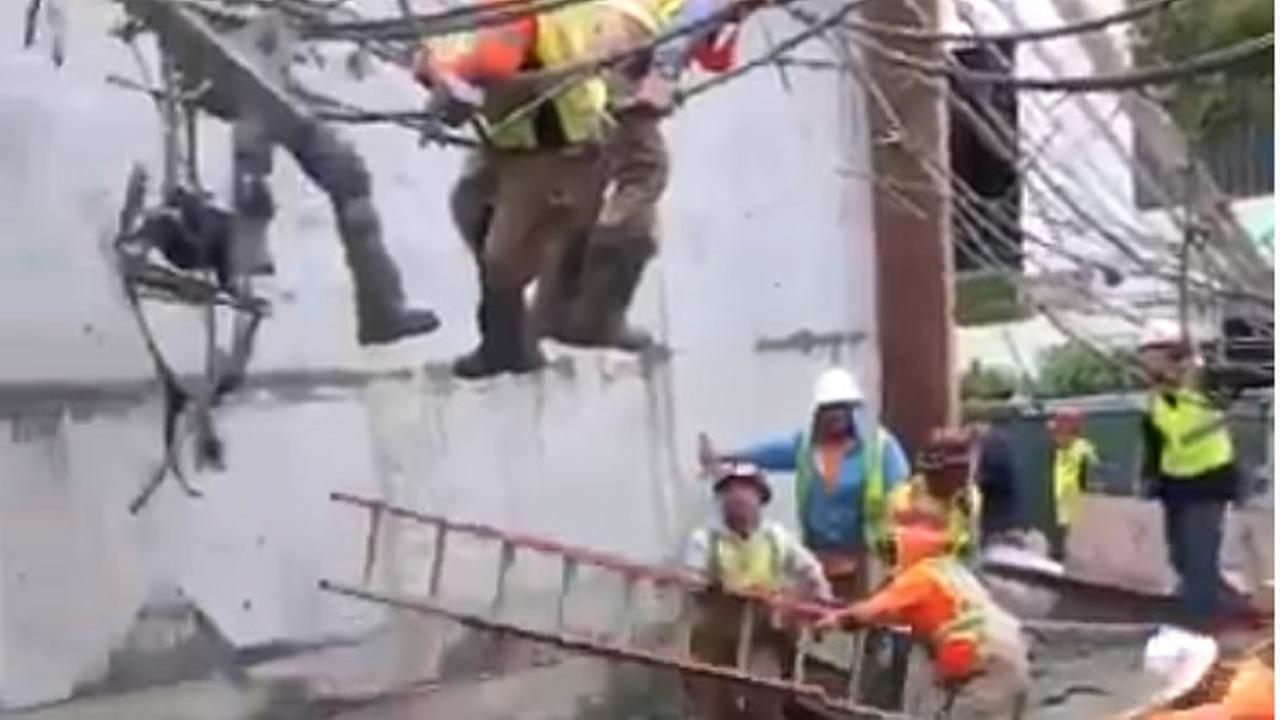 EXCLUSIVE VIDEO Construction workers dangle from